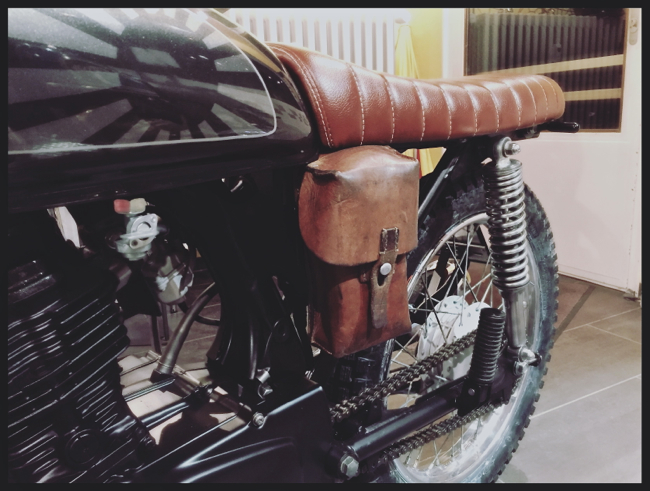 Honda CG 125 battery holder made out of a leather bag